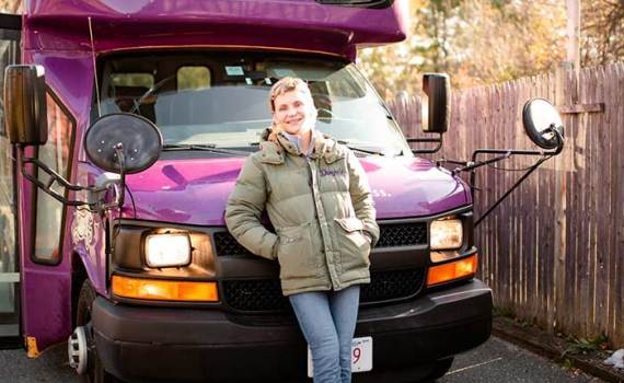 Dingos Dogsitting owner Nancy with the purple bus