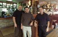WATERBURY, CT 10/15/02- 1015BZ02.02- From left- Gene DiCorpo, manager, Jared Caiazzo, owner/manager, and Jerry Caiazzo, owner, pose in the dining room of Big Frank's on Watertown Avenue. For Features. JAMISON C. BAZINET PHOTO