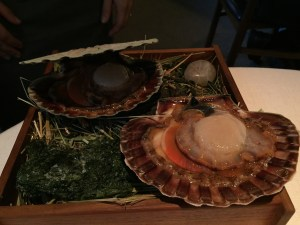 live scallop presented to be prepared for next course
