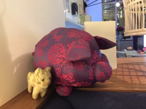 Frankie hung out with the pig(?) pillow