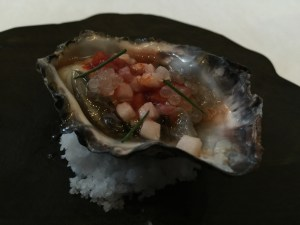 New Zealand oyster, pork belly and pepper