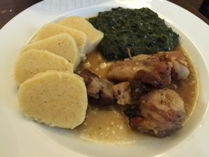 juicy pieces of pork, spinach and dumplings