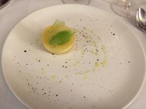 Lemon tart with goat cheese sorbet, olive oil, tea and sugar gremola