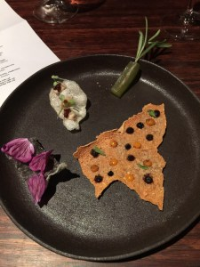 amuse: potato chip, pickled cucumber on rosemary, beef chip, panfried fish skin with flowers