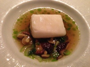 Slow cooked halibut with bok choy, green garlic and mushroom broth