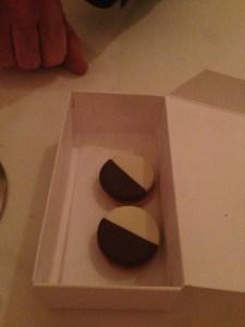 Sweet black and white chocolate cookie with raspberry ganache