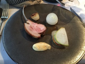 "Suckling ""Noir de Bigorre"" pig, Cevennes onion, pear shavings, sage"
