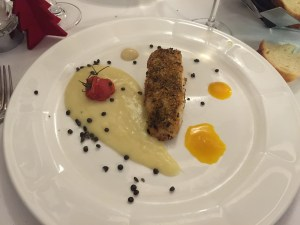 Wild sea bass in a crust of petit herbs on a bed of potato cream