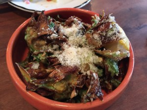 Fried artichoke with garlic butter and Parmesan.
