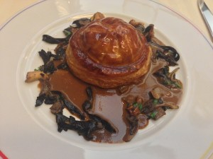 Game pie with mushrooms - including duck, pheasant, pigeon, foie gras, pepper sauce and truffles