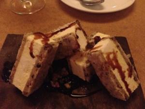 Spiced cocoa nib 'ice cream' sandwich, black pepper pecans, plum fudge