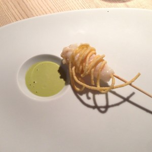 Fried langoustine roll with mandarin essence and pistachio sauce