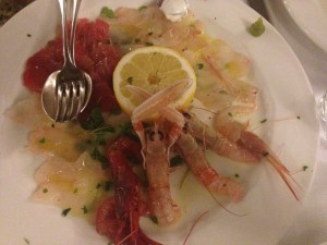 Carpaccio of John Dory, Tuna, Sea Bass, Langoustine, Canoce, Shrimp with sour cream sauce and dot of green horseradish