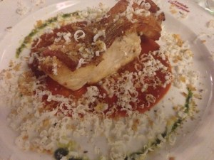 Scorpion fish with tomatoes, cream, grated Buffalo Ricotta and crispy bread