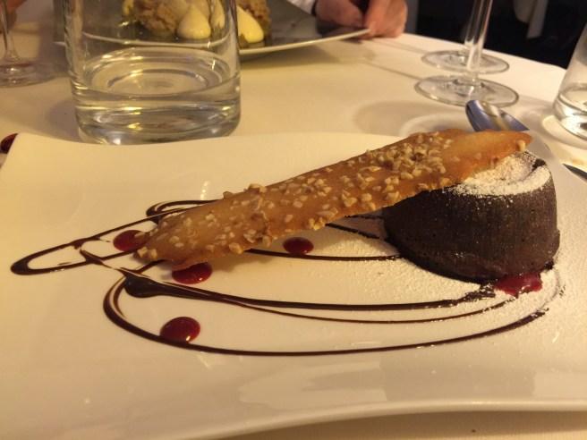 Molten chocolate souffle cake with almond waffle