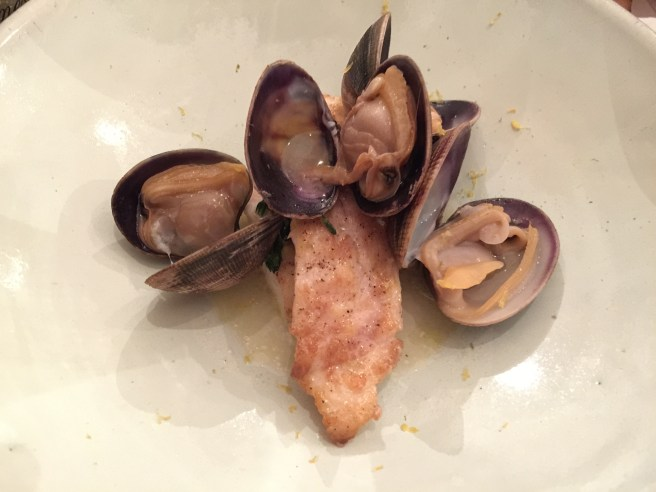 Roasted stone bass, clams