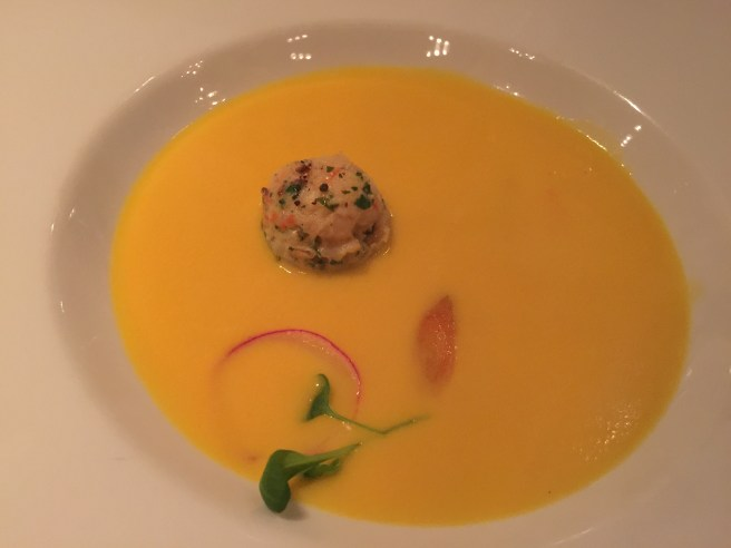 Yellow carrot soup with spicy curry shrimp ball.