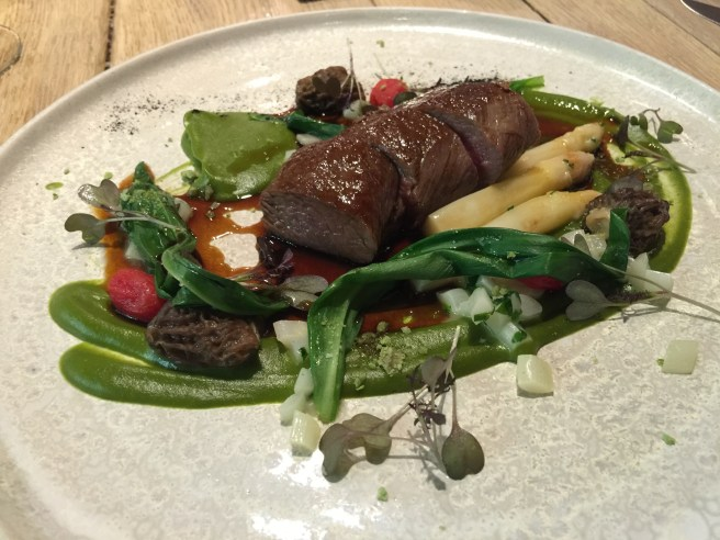 Lamb with wild garlic purée, white asparagus spears and dice, morells