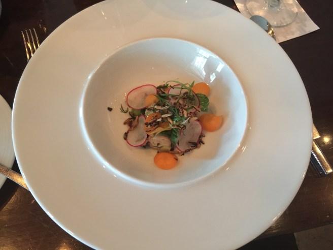 Charred octopus salad, half sour bok choy, wakame, herbs, thai vinaigrette