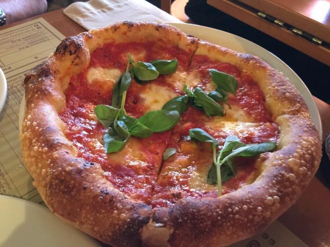 Pizza Margherita with tomato, mozzarella and basil
