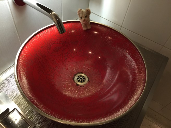 Frankie liked the red sink