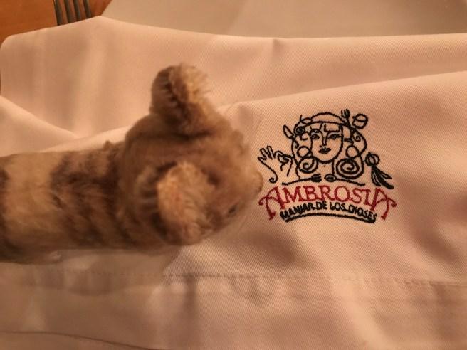 Frankie studied the napkin embroidery