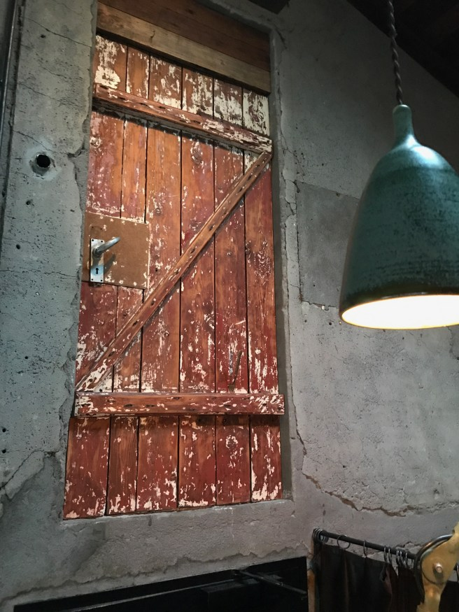 door to old hay loft, above entrance to other dining area