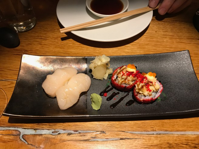 yuzu scallop and Volcano Langoustine maki with langoustine tartar with sesame oil, 7 spice and chilli on top of maki roll with salmon and cucumber