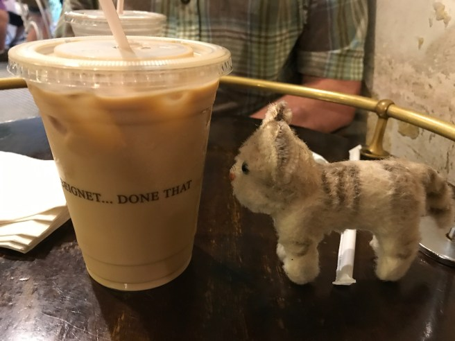 Frankie inspected the ice coffee au lait