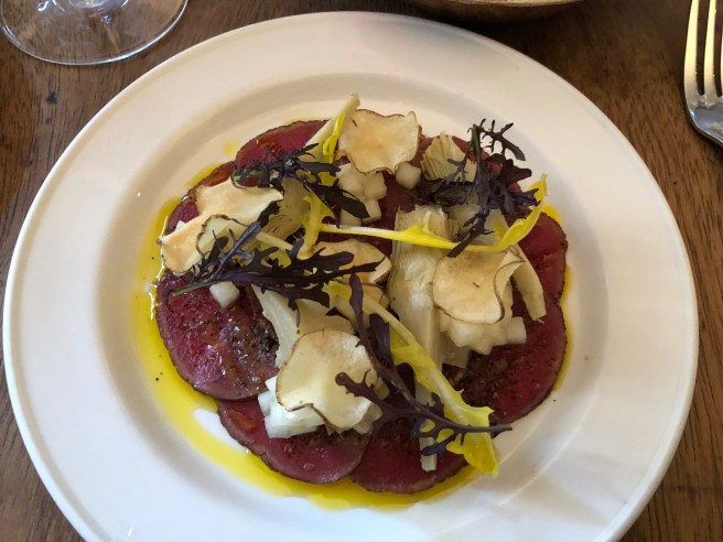 Deer carpaccio, artichoke, pickled pear and juniper