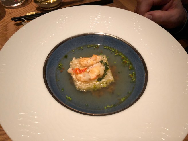 Upside down Sizzling Rice Soup: Poached lobster, Bottarga, Mirepoix