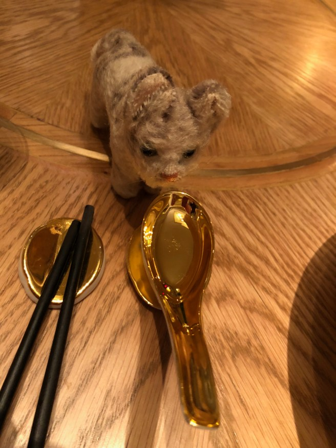 Frankie was fascinated by the gold spoon