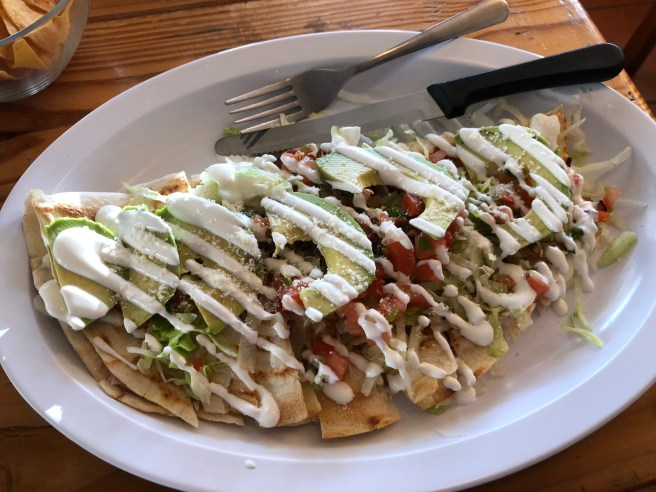 Zincro: Quesadilla stuffed with cheese and ham (choice of beef, grilled chicken or ham) and topped with lettuce, pico de gallo, sour cream and avocado slices