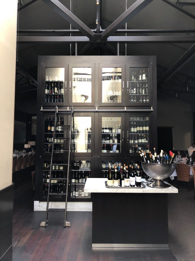 wine cabinet divides kitchen area from dining room