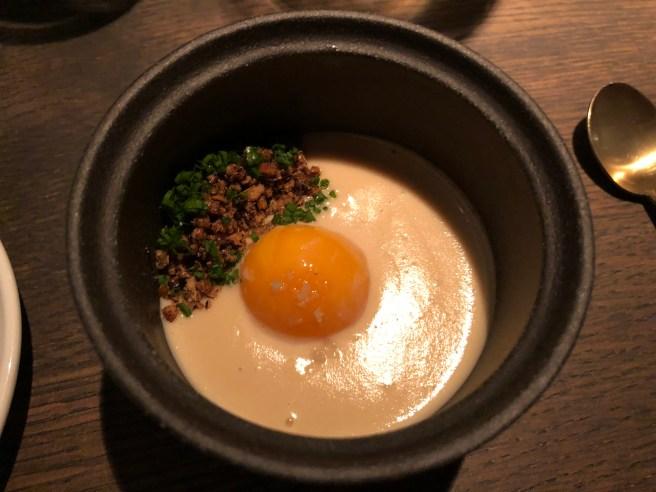 Slow poached egg yolk, smoked dates, alliums and malt