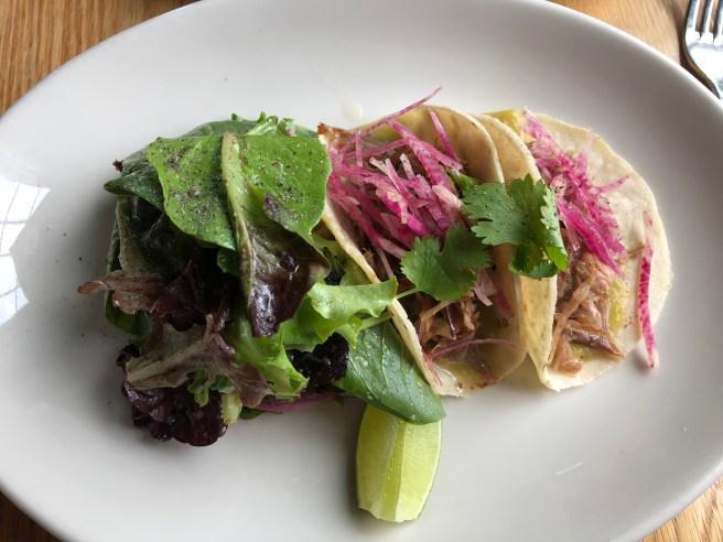 Duck carnitas tacos, radish, salsa verde, cilantro, mixed greens