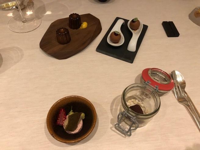 last treats: ecco truffle; blackcurrant & caramel chocolate; raspberry, black vanilla, pumpkin seed; canelé, tonka bean, passion fruit