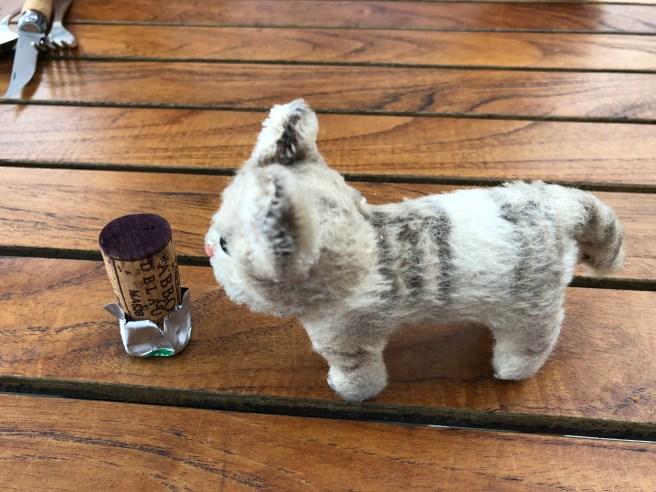 Frankie pondered the foil on the cork