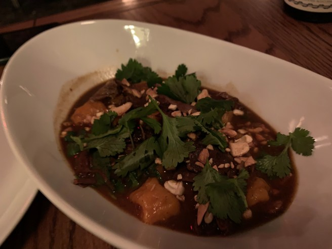 Curried Goat, sweet potato gnocchi, cashews