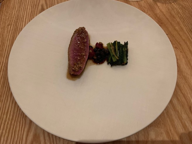 Aged duck ragout of innards, feet, preserved huckleberries and black chestnut