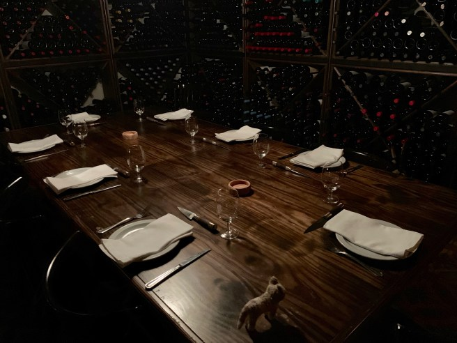 Frankie checked out the table in the wine cellar