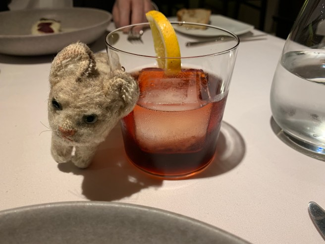 Frankie relaxed with a negroni