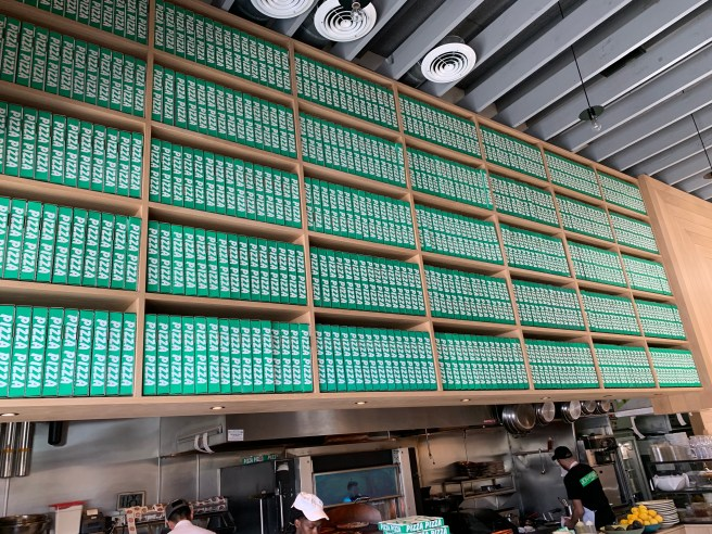 wall of pizza boxes
