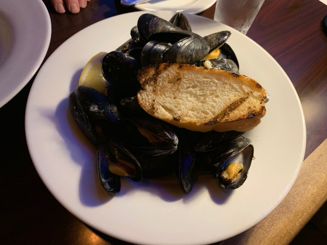 Newfoundland Organic Mussels, steamed, white wine roasted garlic butter sauce, toasted baguette