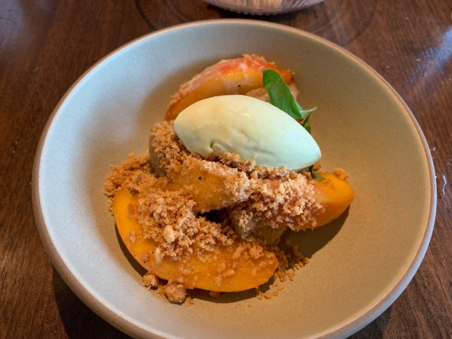 Butterscotch Peaches, brown butter financier and basil ice cream