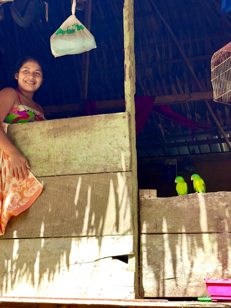 Embera girl with pretty parrots