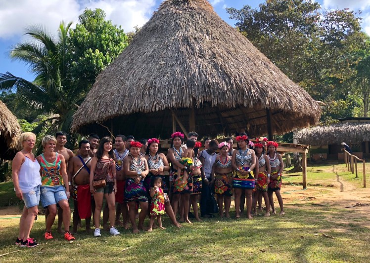 Embera tribal members posing with visitors