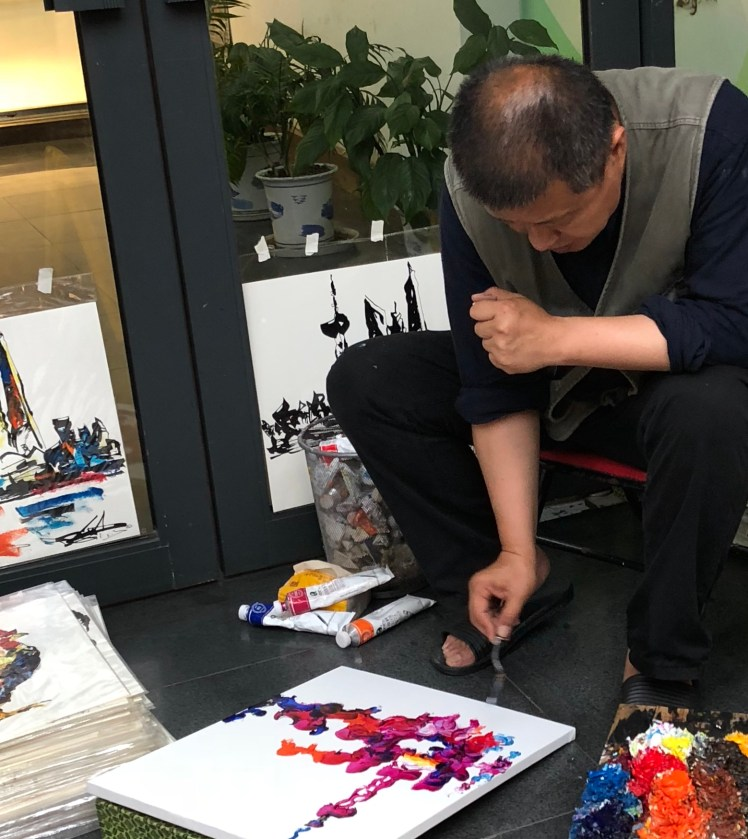 Artist at work in Tianzifang, Shanghai