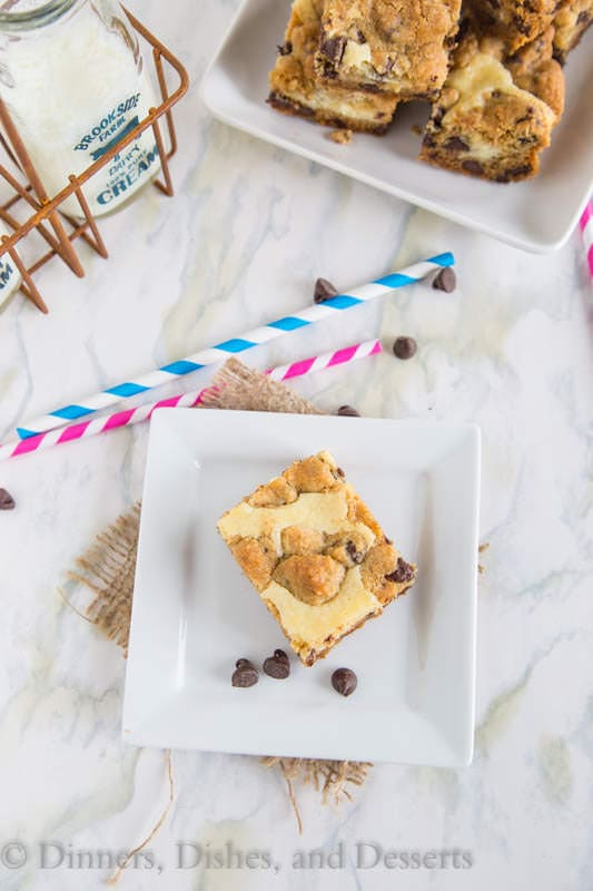 Chocolate Chip Cheesecake Bars - chocolate chip cookie bars with a layer of cheesecake in the center. So yummy!