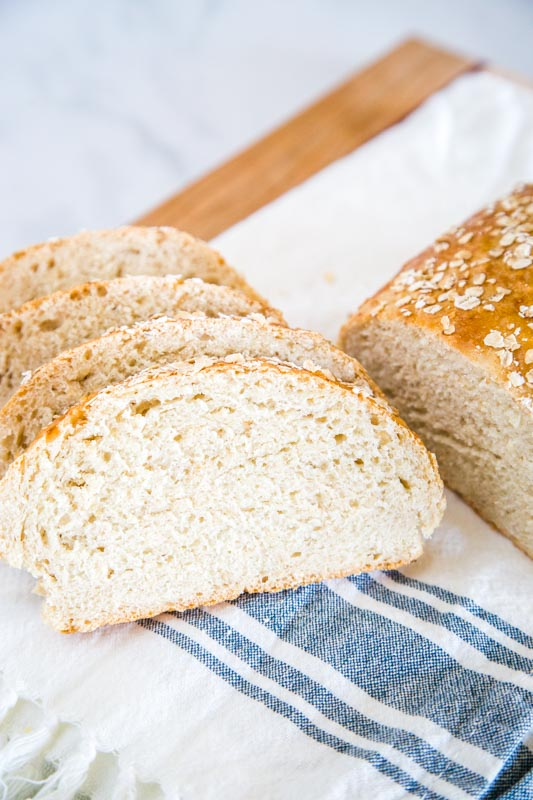 Easy no knead honey oat bread that is great for breakfast, snacking, or dinner